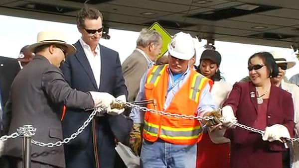 Lt. Gov. Gavin Newsom cuts ceremonial Bay Bridge chain