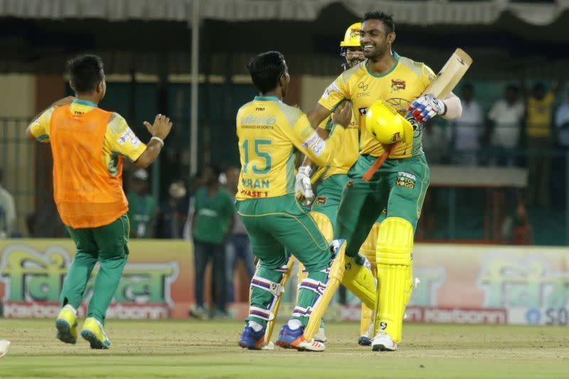 Mithun celebrates with his team-mates after sealing the match for the Bulls
