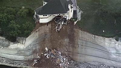 Raw: House Teeters on Edge of 75-foot Cliff