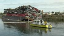 Barge tips over on Victoria waterfront