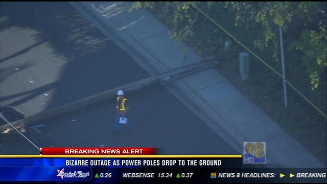 Bizarre outage as power poles drop to the ground