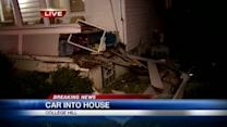 Car hits house; Police say driver arrested