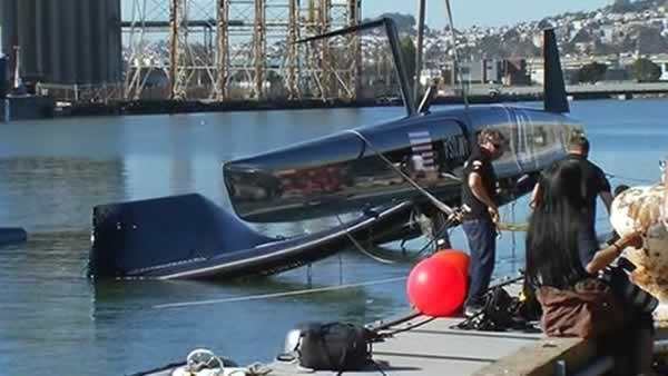 Oracle Team USA pulling capsized yacht from water