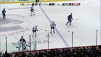 Bieksa crushes Hjalmarsson along the boards