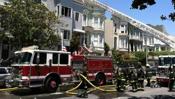 San Francisco cop rescues woman from burning building