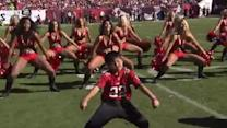 Kid Dances With NFL Cheerleaders