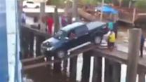 Driver loads car onto boat like a boss