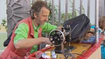 Man uses sewing machine to mend struggling neighborhood