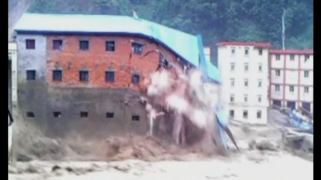 Buildings collapse in China floods