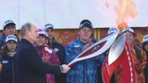 Putin, Security Guard Light Olympic Torch