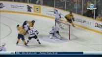 Mike Fisher chips it past Scrivens
