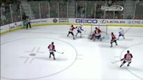 Crawford sticks his pad out to deny Bourque