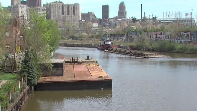 Noon: Barge raised in Cuyahoga River