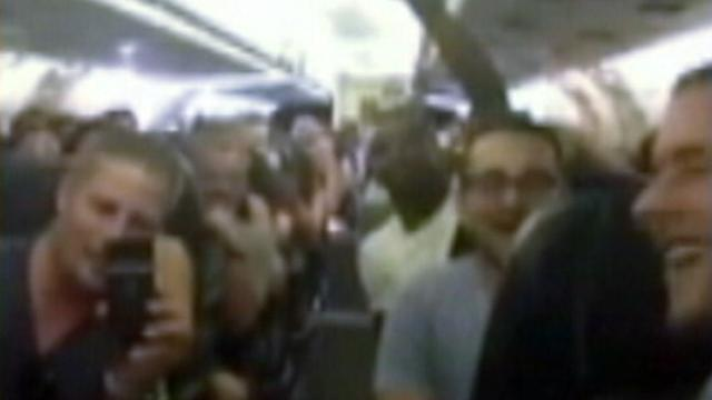 Stuck Passengers Sing 'I Believe I Can Fly' on Tarmac