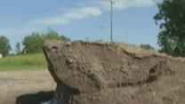 Raw: MN Snow Pile Still Lingers in Summer Heat