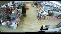 Raw video: Armed robber strikes at 7-Eleven