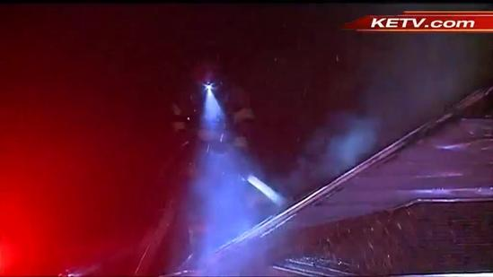 Roof collapses as crews battle Omaha house fire