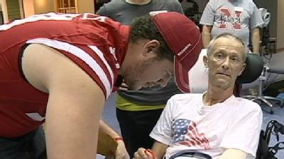 Huskers Pay Holiday Visit To Hospital
