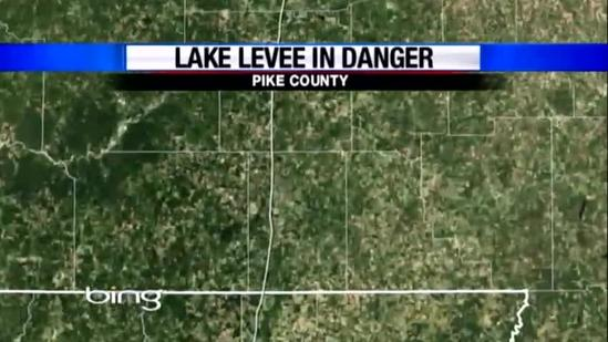 Crews continue to drain lake after levees threatened
