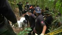 Migrant remains exhumed in Malaysian jungle camp