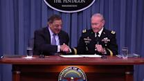Panetta, Dempsey sign order opening combat to women