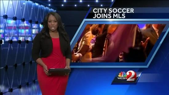 Fans celebrate Orlando City Soccer's entry into MLS
