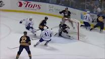 Trevor Smith chips puck over net to Kulemin