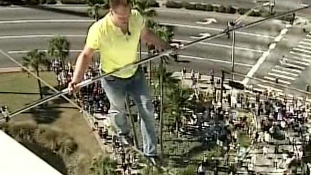 Tightrope walker crosses highway without a net