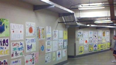 Kids' Hornets Posters Line Hallway To Court