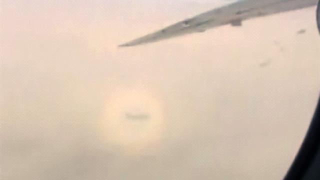 Caught on Tape: Rainbow surrounds airplane