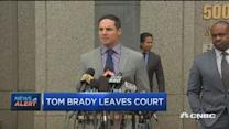 Tom Brady leaves court