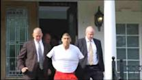 Aaron Hernandez brought out of house in handcuffs