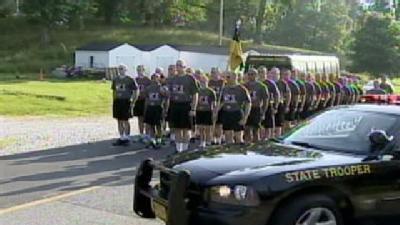 Torch Run Connects Police With Special Olympics