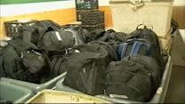 Group hands out backpacks to help with cold snap