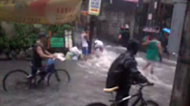 Floods Cascade Along Mandaluyong City Streets as Cyclists Navigate Roads