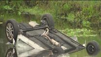 Kids trapped in flipped car rescued