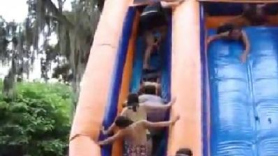 Woman Takes Out Kids On Waterslide