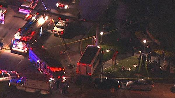 Aerials of fatal accident involving pedestrian and bus