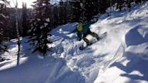 Snowboarder Crashes into Small Snow Hill