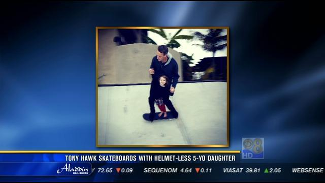 Tony Hawk skateboards with helmetless five-year-old daughter