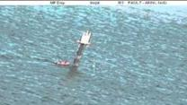 Fishermen Cling to Channel Marker in Choppy Waters Off Darwin