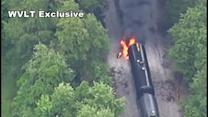 Freight train derails, catches fire