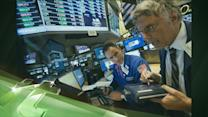 Latest Business News: S&P 500 Index Has First Close Above 1,700 Points
