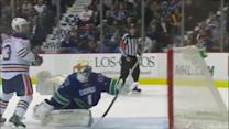 Roberto Luongo volleys the puck out of danger