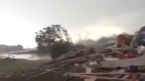 Family Comes Out of Cellar After Tornado