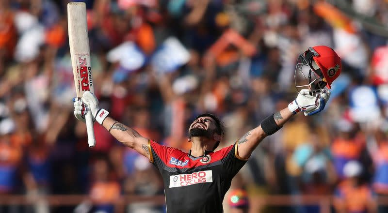 Virat Kohli celebrates after reaching the three-digit landmark for the first time in his IPL career