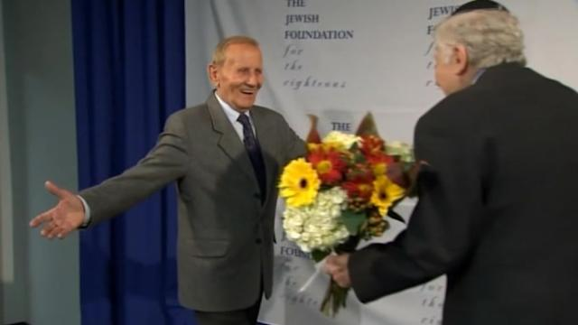 Holocaust survivor reunites with man whose family saved him during World War II