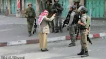 Elderly Palestinian man confronts Israeli soldiers