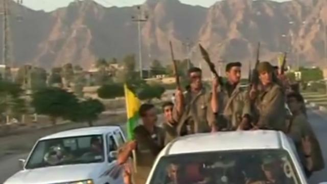Warm welcome in Kirkuk for convoy of Kurdish fighters