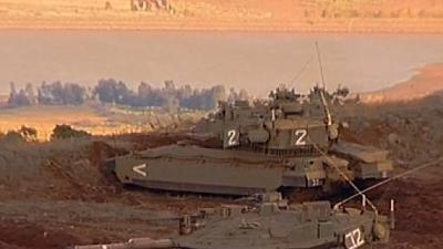 Raw: Israeli tanks fire into Syria